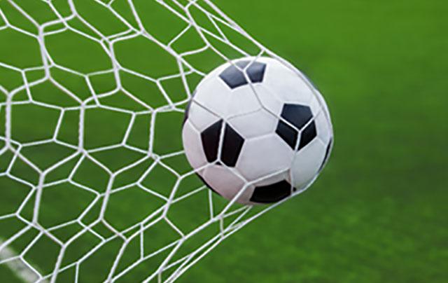 Ball being caught in a goal net